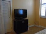 ヒルトンラグーンタワーL1568号室ベッドルームのテレビ.JPG